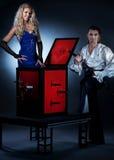 Ouple performing sword box illusion. Attractive couple performing sword box illusion stock photography