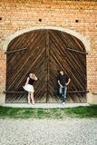 Ouple stands before old door Royalty Free Stock Photography