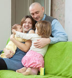 Ouple together with two  children Royalty Free Stock Images