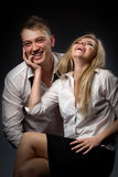 Сouple in white shirt and black tie. Photo of a couple in white shirt and black tie, the men holding sexy woman Stock Images