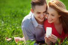 Сouples with phone taking selfie self portrait at the park Royalty Free Stock Photography