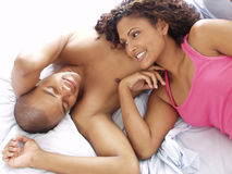 Our bed. Afro american couple on bed Royalty Free Stock Photos