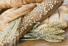 Our bread of every day. Some bread and cereals on a bamboo mat Royalty Free Stock Images