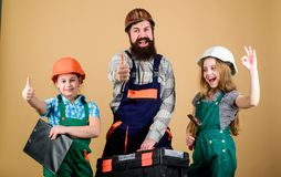 Our dad has skillful fingers. Home renovation. Create room you really want live. Follow father. Father builder kids. Girls. Teach daughter. Informal education royalty free stock photo