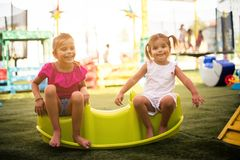 Our day is full of fun and laughter. Two little smiling girls playing together stock images