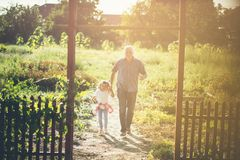 Our days are always full of fun. Grandfather and granddaughter on failed. Copy space stock photo