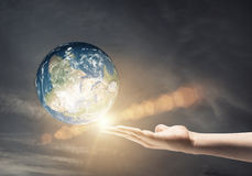 Our Earth planet. Human hand holding Earth planet. Elements of this image are furnished by NASA royalty free stock photos