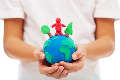 Our environment and us concept. With modelling clay earth in child hands Royalty Free Stock Photography