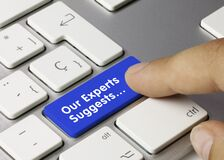 Our Experts Suggests... - Inscription on Blue Keyboard Key