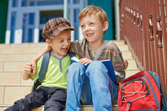 Our first day in school. Two happy kids. stock photo