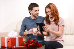 It is our first photo together. Attractive young loving couple s Stock Photography