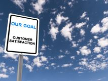 Our goal. White roadside style sign on a metal post with blue text 'our goal' and below it 'customer satisfaction', background of blue sky and cloud Royalty Free Stock Images