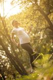 Our health is the most important. Pregnant woman jogging and exercise trough park. Close up. Copy space stock images
