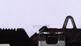 Our history of life. Close-up. Our life story is the title of a new chapter in a book printed on a retro typewriter. Close up stock footage