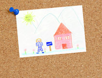Our house is sold. Child's picture of sold house attached to corkboard Royalty Free Stock Images
