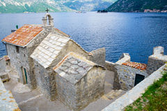 Our Lady of the Angles chapel, Bay of Kotor. Our Lady of the Angles chapel, with the bay of Kotor, the islands Our Lady of the Rocks and Saint George, and Perast royalty free stock images
