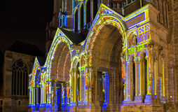 The Our Lady of Chartres cathedral illuminated during Chartres Light show. Colorful light illumine historic places and some principal buildings throughout the Stock Images