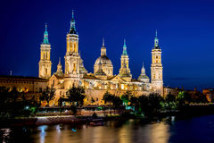 Our Lady of the Pillar Basilica with Ebro River at dusk Zaragoza Royalty Free Stock Photos
