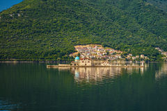 Our Lady of the Rock Island. And Church in Perast on shore of Boka Kotor bay Boka Kotorska, Montenegro, Europe Royalty Free Stock Photography