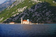 Our Lady of the Rock and St George islands in Perast on shore of Boka Kotor bay Boka Kotorska, Montenegro Stock Photos