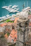 Our Lady of Salvation bell tower and view of Kotor marina stock image