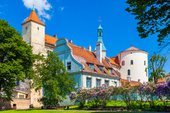 Our Lady of Sorrow catholic church and medieval house in Riga. Our Lady of Sorrow catholic church and medieval house on old street in Riga, Latvia royalty free stock images
