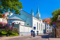 Our Lady of Sorrow catholic church and medieval street in Riga. Our Lady of Sorrow catholic church and medieval street in old Riga city, Latvia royalty free stock photos