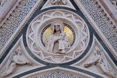 Our Lady of Sorrows supported by Angels bearing Flowers, Portal of Florence Cathedral. Our Lady of Sorrows supported by Angels bearing Flowers, Portal of stock photos