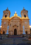 Our Lady of Victory church, Xagra, Gozo, Malta. Evening view of illuminated Church of Our Lady of Victory in Xagra, Gozo island, Malta Stock Photo
