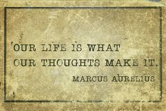 Our life MA. Our life is what our thoughts make it - ancient Roman philosopher Marcus Aurelius quote printed on grunge vintage cardboard Stock Images