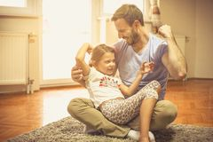 Our love is strong. Father and daughter playing at home royalty free stock images