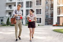 Pleasant young people having a walk royalty free stock photos