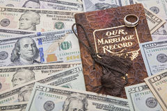 Our marriage record document wedding ring money. The nuptial financial agreement concept is reflected in the image of the marriage record, golden wedding band Royalty Free Stock Image