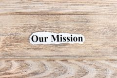 Our Mission text on paper. Word Our Mission on torn paper. Concept Image.  Royalty Free Stock Photography