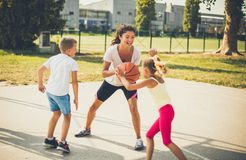 Our mom is the best basketball player ever. Family royalty free stock image