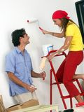 Our new home. Young couple painting and moving to a new home Royalty Free Stock Photos