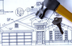 Our New Home. Blueprint of New Custom Home with the Door Key and a Hammer Stock Images
