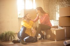 Our new life starts now. Couple sitting in apartment and talking. Copy space stock photography