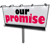 Our Promise Billboard Message Advertising Guarantee Vow Service. Our Promise words on a billboard or sign to advertise a guarantee, promise or vow of great Royalty Free Stock Photo
