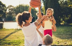 Our team is the winner. Family playing basketball. Close up stock images