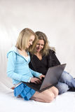 Our time. Mother and daughter chating on laptop together stock photos