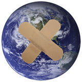 Our world is Plastered!. Heal the world - plaster on planet earth Stock Photo