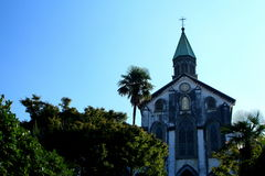 Oura Catholic Church in Nagasaki. Oura Catholic Church of the fresh green Royalty Free Stock Photos