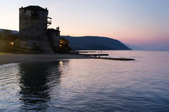 Ouranoupolis castle silhouette in sunrise, Greece. Ouranopolis, the place where boats or ferry go to Mount Athos stock photo