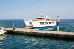 Ouranoupolis harbor and ferry boat Agia Anna near the pier, Greece Royalty Free Stock Photo