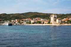 Ouranoupolis town view, harbor, ferry boat and Tower, Athos, Greece Royalty Free Stock Images