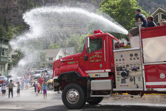 Ouray Firetruck squirts off kids Stock Image