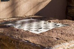 Ourdoor Checkers Game. This outdoor game table is a popular spot in Santa Fe, New Mexico royalty free stock images