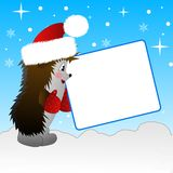 Ouriço em um em-campo da calota de novo-ano Imagem de Stock