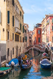 Ourists in gondolas on canal in Venice city Stock Photography